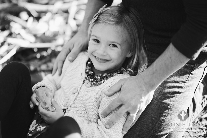 San-Francisco-lifestyle-children-photography-young-girl-laying-against-her-dad-BxW