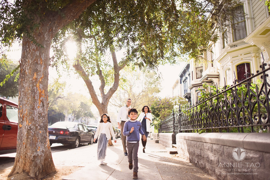 San-Francisco-lifestyle-family-photography-running-on-sidewalk-in-city