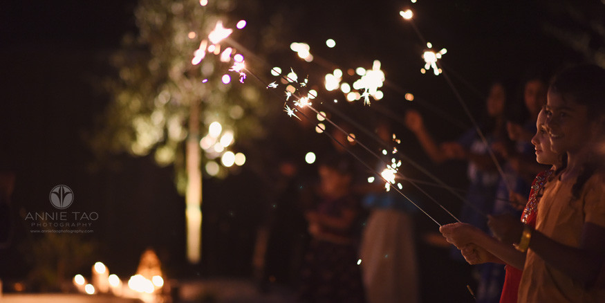 East-Bay-event-photography-children-holding-sparklers-at-night-for-Diwali-sideview
