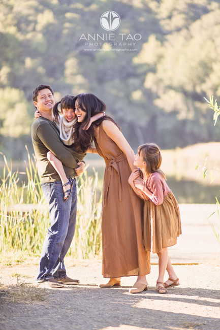 Bay-Area-lifestyle-family-photography-standing-carrying-and-holding-hands-by-lake