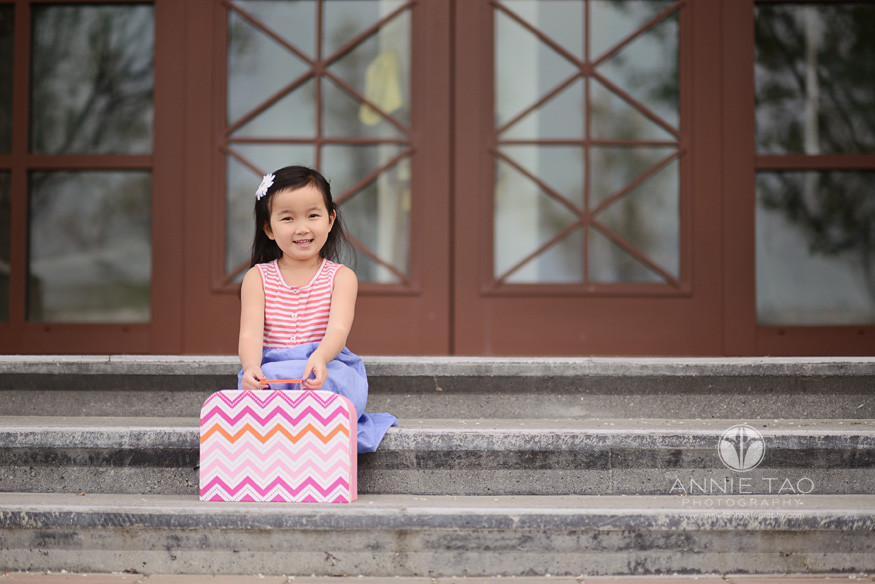 East-Bay-styled-children-photography-preschool-girl-sitting-on-stairs-with-suitcase