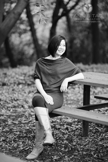 East-Bay-lifestyle-photography-woman-sitting-at-picnic-table-in-woods-BxW