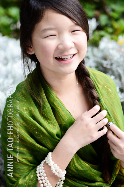 Preteen-model-styled-photography-dressed-in-green-laughing