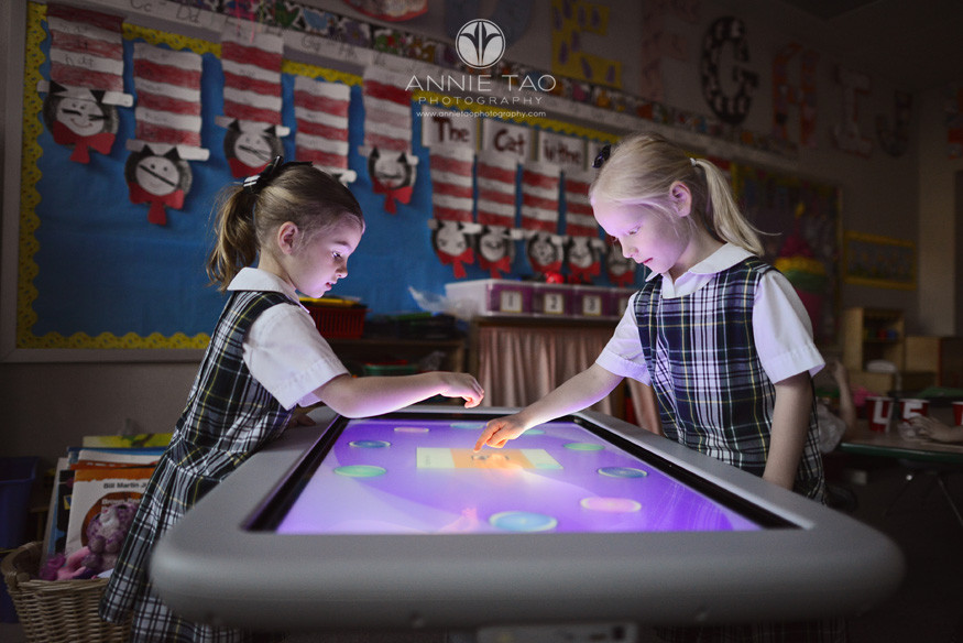 Commercial-education-photography-two-girls-working-on-electronic-table-tablet