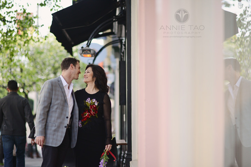 San-Francisco-lifestyle-engagement-photography-man-leaning-in-for-a-kiss-while-window-shopping-by-stores