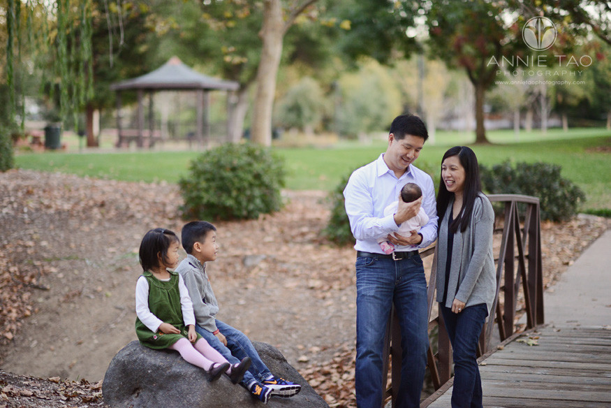 East-Bay-lifestyle-family-photography-family-looking-at-baby-by-bridge