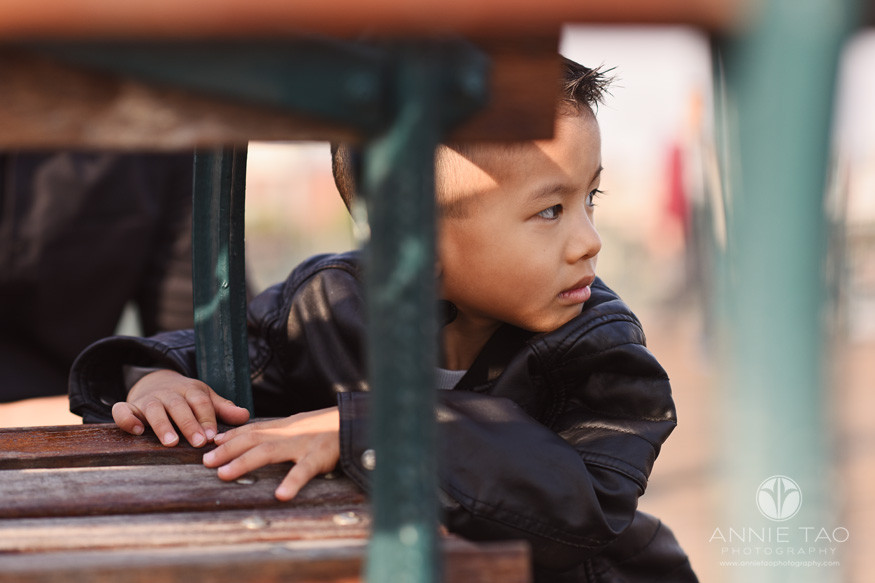 San-Francisco-lifestyle-children-photography-preschool-boy-crouched-by-bench