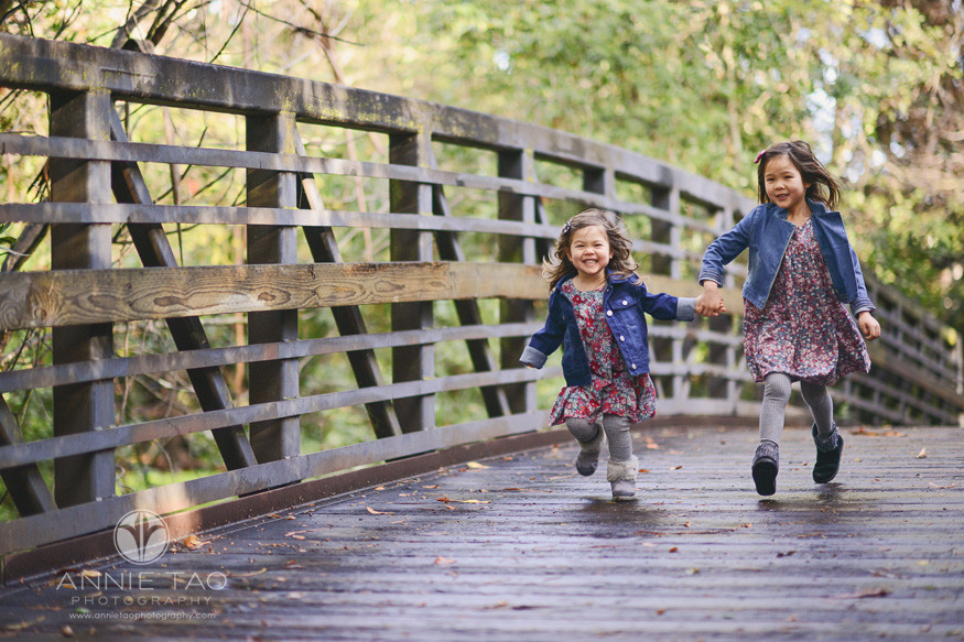 bay-area-lifestyle-children-photography-laughing-sisters-holding-hand-on-bridge
