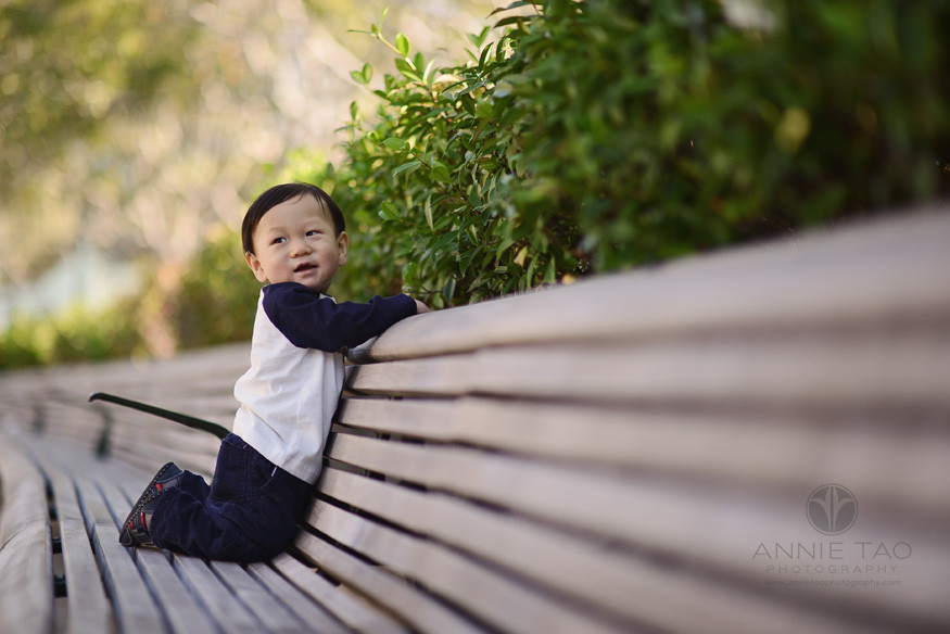 San-Francisco-lifestyle-baby-photography-12-month-old-baby-boy-happy-on-long-bench