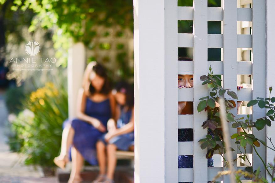 Bay-Area-San-Francisco-lifestyle-children-photography-girl-peeking-through-trellis-hole