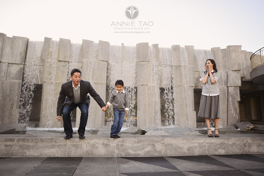 San-Francisco-lifestyle-family-photography-woman-watching-her-son-jumping-with-husband-2