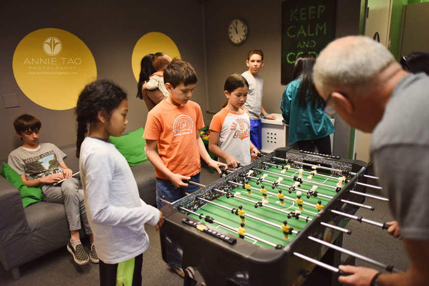 East-Bay-commercial-photography-kids-teens-parents-playing-games-in-lounge