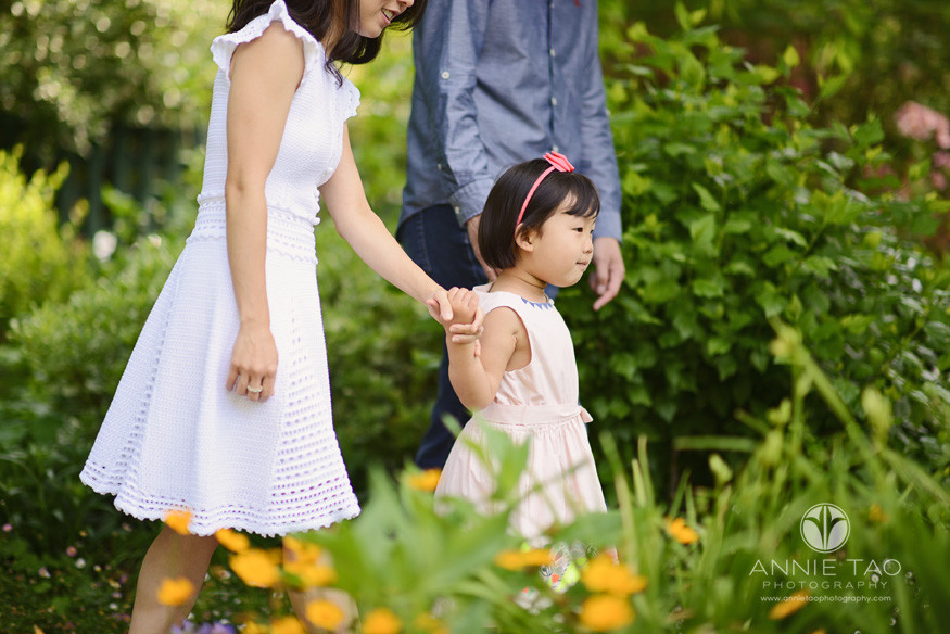 Bay-Area-lifestyle-children-photography-three-year-old-girl-leading-parents-through-garden