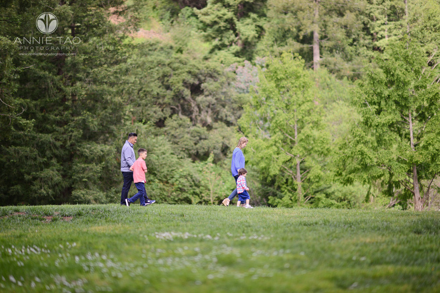 East-Bay-lifestyle-family-photography-family-of-four-walking-across-field-by-mountainside