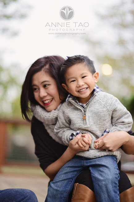 East-Bay-lifestyle-family-photography-woman-holding-smiling-son-on-lap