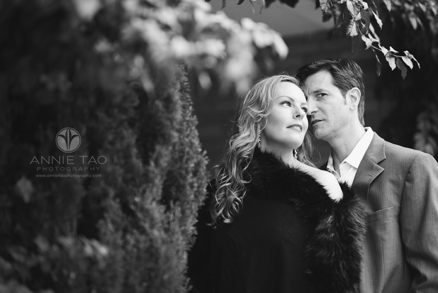 San-Francisco-couple-lifestyle-photography-man-and-woman-with-serious-faces-by-a-bush-BxW