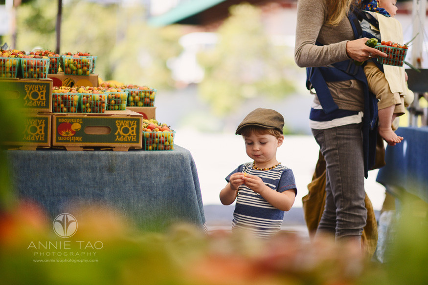 East-Bay-Commercial-Photography-young-boy-with-hat-taste-testing-while-his-mom-shops-at-Berkeley-farmers-market