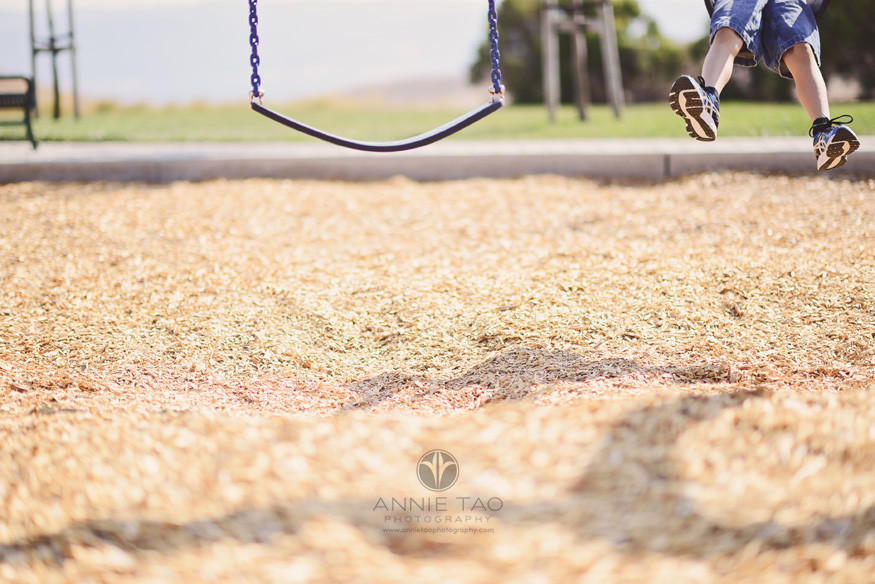 East-Bay-lifestyle-children-photography-young-boy-swinging-feet-only