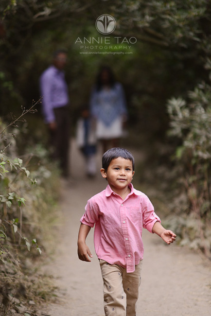 San-Francisco-lifestyle-family-photography-young-boy-runs-in-front-of-family