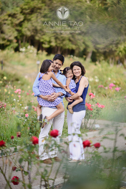 East-Bay-lifestyle-family-photography-happy-family-in-blue-and-white-among-roses
