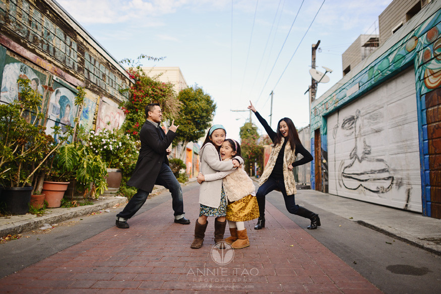 San-Francisco-lifestyle-urban-family-photography-girls-hugging-while-parents-rock-out