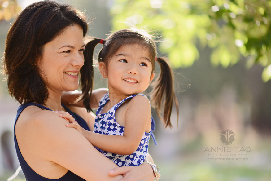 East-Bay-lifestyle-family-photography-mother-holding-toddler-girl-with-beautiful-light