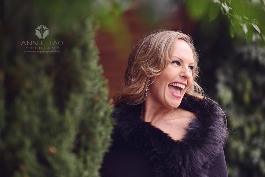 San-Francisco-lifestyle-photography-woman-in-formal-attire-laughing-by-bush