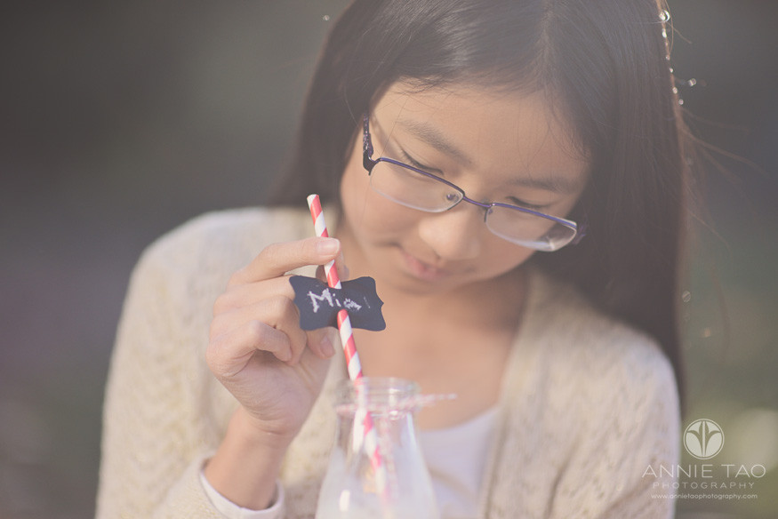 East-Bay-children-lifestyle-photography-girl-in-glasses-looking-at-drink