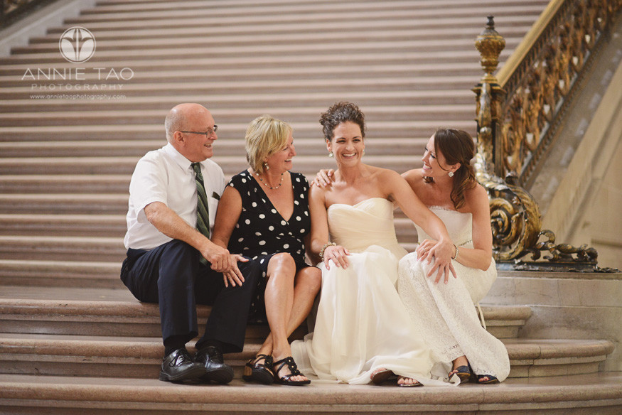 San-Francisco-wedding-photography-City-Hall-gay-wedding-newlyweds-sitting-with-family-on-stairs