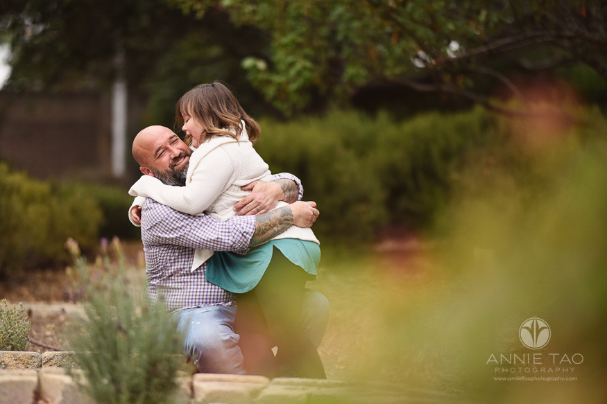 San-Francisco-Bay-Area-commercial-photography-lifemoves-girl-sitting-on-dads-lap-in-garden