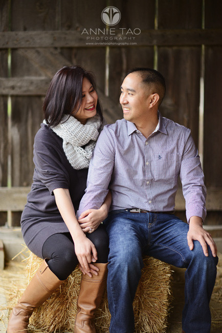 East-Bay-lifestyle-photography-couple-looking-at-each-other-on-haystack