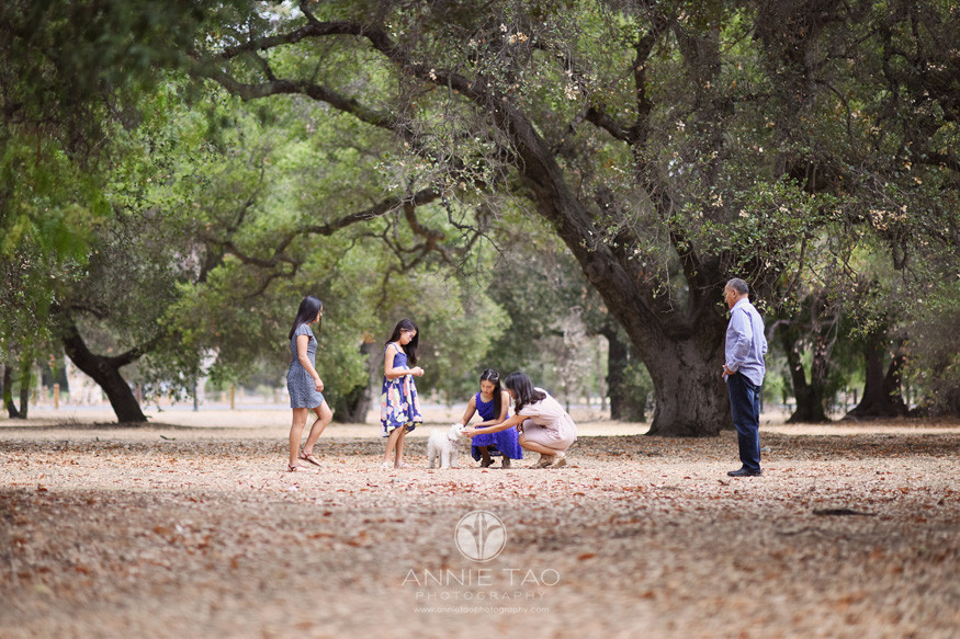 Bay-Area-lifestyle-family-photography-standing-together-with-puppy-far-view