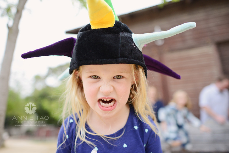 east-bay-lifestyle-children-photography-young-girl-looking-fierce-with-a-dragon-hat