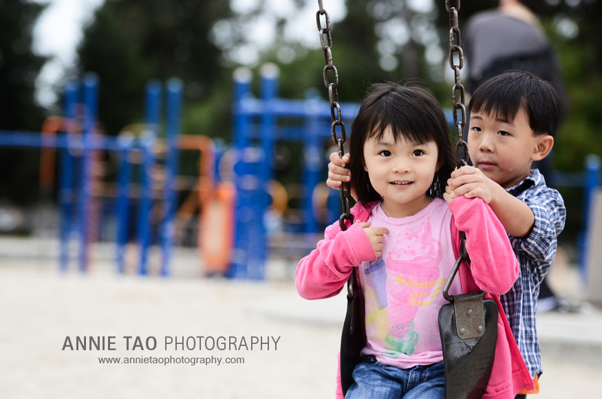 San-Mateo-lifestyle-family-photography-Pushing-Cousin-on-Swings