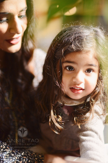 san-francisco-lifestyle-family-photography-girl-looking-up-while-being-held-by-mom-at-store