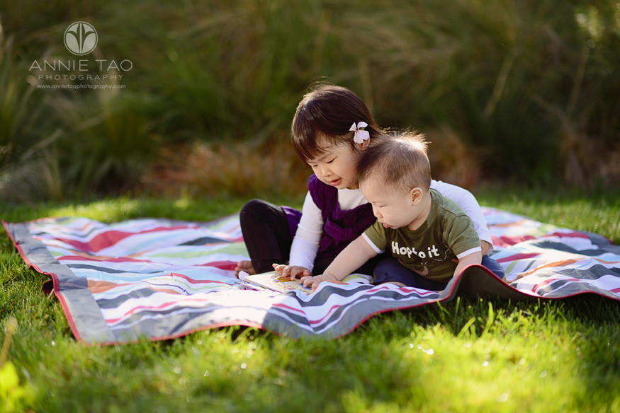 San-Francisco-lifestyle-children-photography-toddler-girl-hugging-baby-brother-while-reading