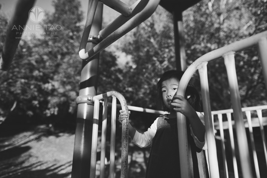 East-Bay-lifestyle-children-photography-young-girl-on-play-structure-BxW