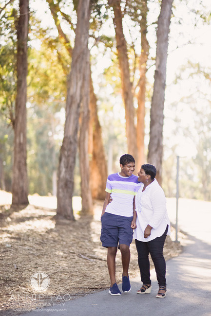 San-Francisco-Bay-Area-lifestyle-family-teen-photography-mom-and-son-laughing-together-on-woodsy-path