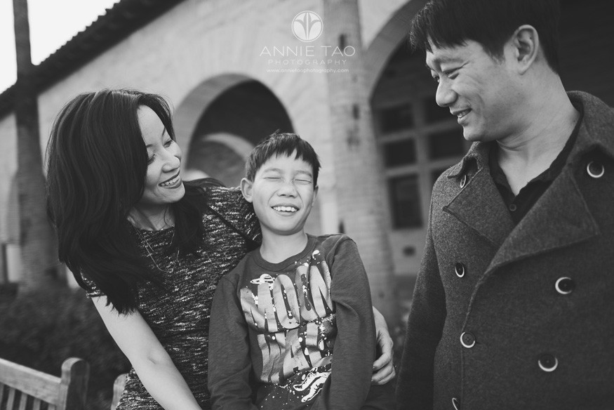Bay-Area-Palo-Alto-family-lifestyle-photography-boy-closing-eyes-with-parents-smiling-nearby-BxW