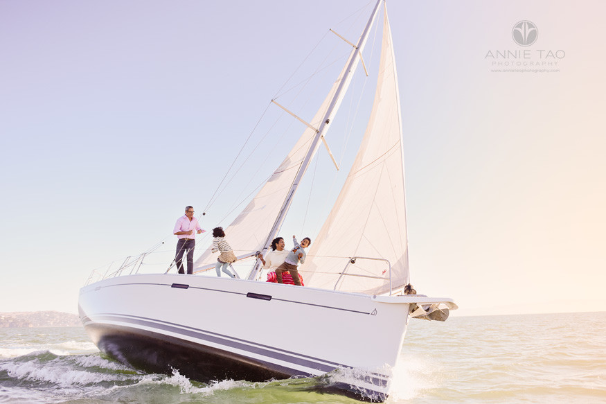 San-Francisco-lifestyle-family-photography-playing-on-boat-while-sailing-in-bay