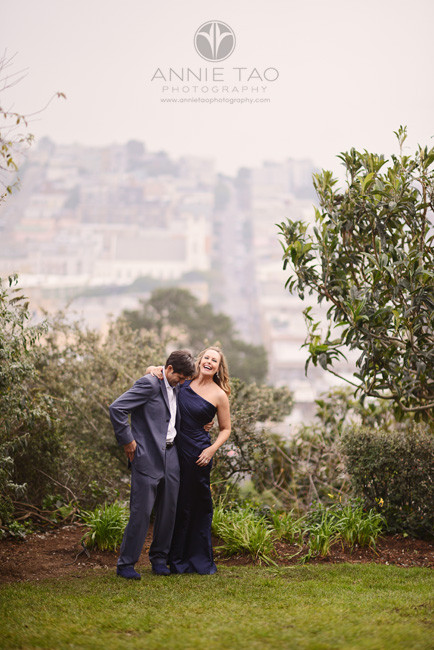 San-Francisco-couple-lifestyle-photography-man-and-woman-laughing-in-park-overlooking-the-city