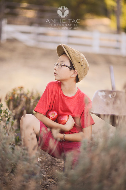 east-bay-styled-children-photography-boy-in-red-holding-apples-looking-to-side