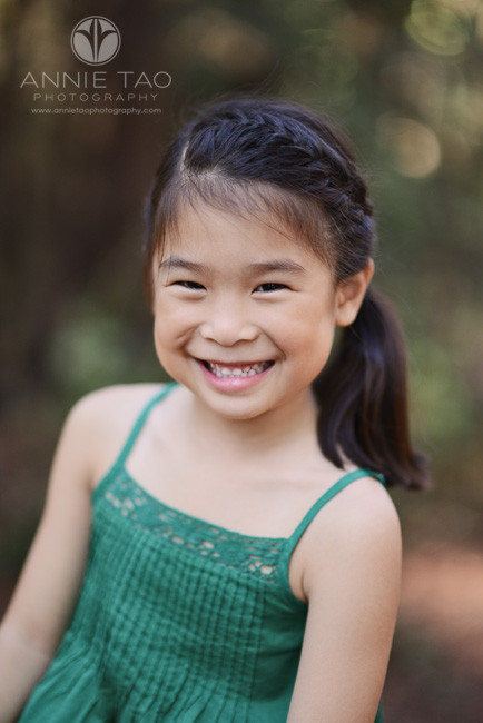 East-Bay-styled-children-photography-smiley-young-girl-in-green-dress