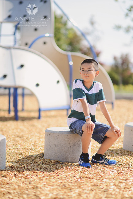 East-Bay-lifestyle-children-photography-smiling-boy-sitting-by-play-structures