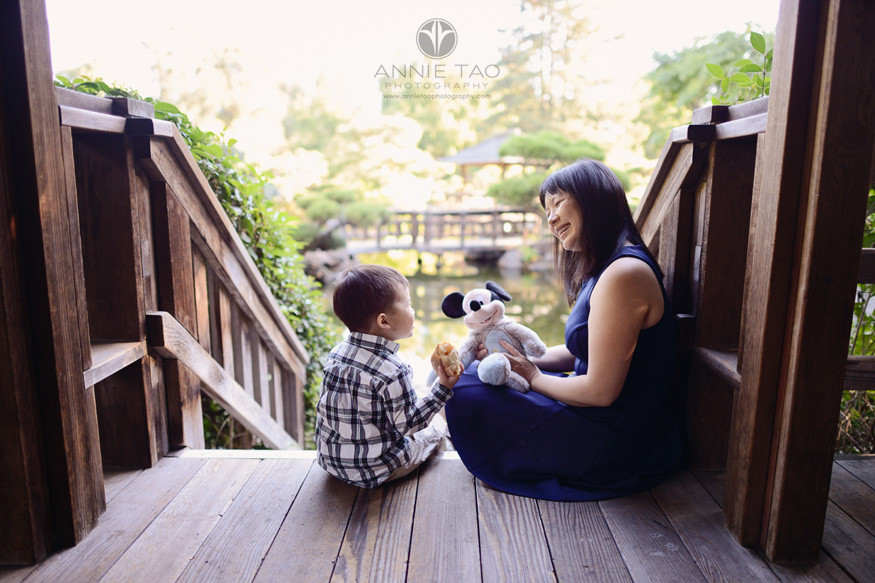 east-bay-lifestyle-family-photography-mom-and-toddler-boy-playing-with-mickey-on-steps