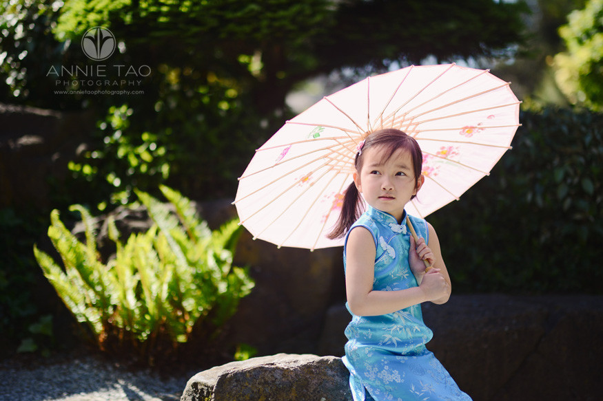 East-Bay-lifestyle-children-photography-young-girl-leaning-on-rock-and-holding-umbrella