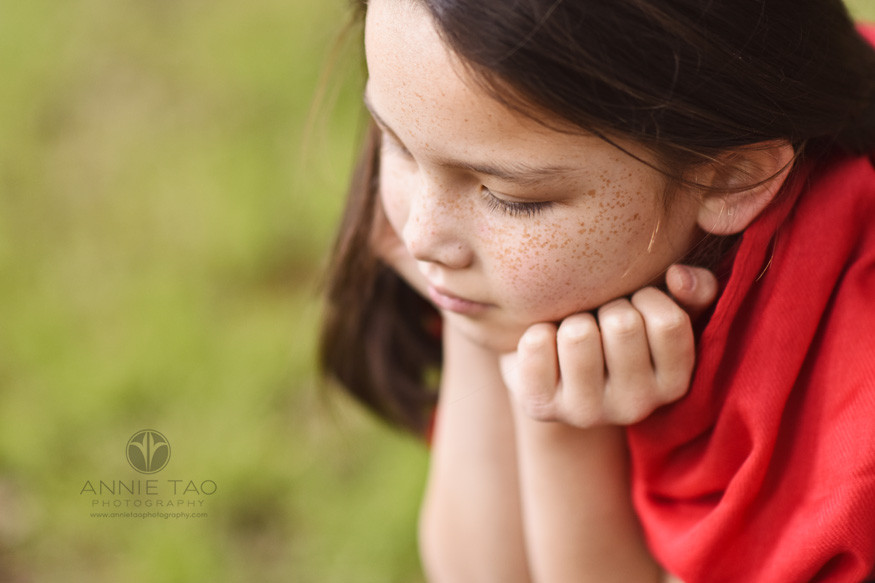 east-bay-styled-children-photography-girl-with-freckles-and-red-scarf-sitting-downward-view
