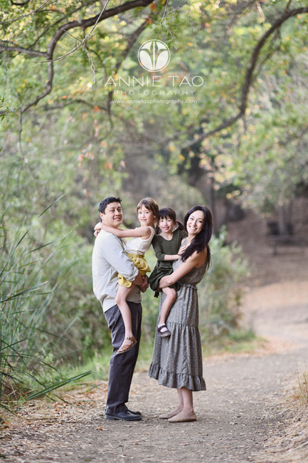 Bay-Area-lifestyle-family-photography-parents-holding-dauhters-in-woods