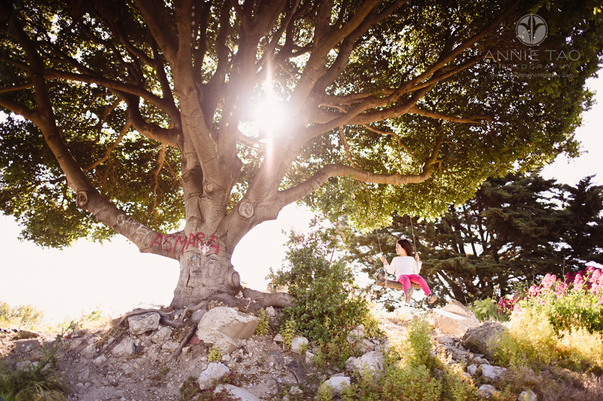 East-Bay-lifestyle-children-photography-young-girl-on-tree-swing-with-sunflare