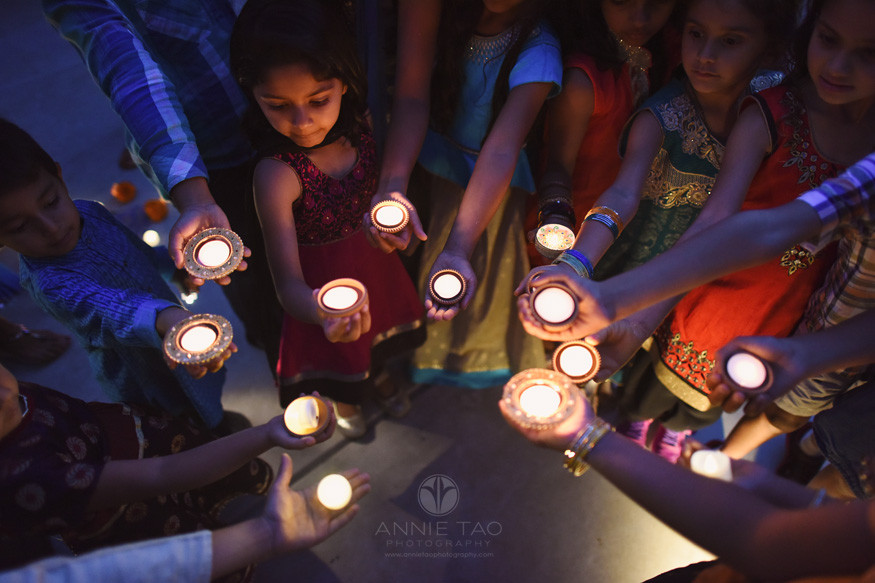 East-Bay-event-photography-children-holding-lit-diyas-in-hands-at-night-diwali-celebration